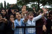 An Asian girl and a white girl screaming at the pop group Damage from behind a barrier at a Mela in a park Manchester, UK - Paul Herrmann - 2000s,2001,ACE arts culture & entertainment,adolescence,adolescent,adolescents,Asian,Audience,AUDIENCES,awe,BAME,BAMEs,barrier,barriers,black,BME,bmes,crowd,crush,cultural,devotion,diversity,ethnic,et