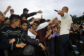 Young Asian men and women watching the pop group Damage at a Mela Asian festival in Manchester - Paul Herrmann - 21-07-2001