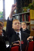 Pupil with hand up at Crompton House school, Shaw, near Oldham, UK - Paul Herrmann - 09-11-2001