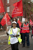 Unite the Union picket line outside Manchester Royal Infirmary, part of a national day of action for pensions and pay, M10, on May 10th 2012 - Paul Herrmann - 2010s,2012,Asian,asian asians,black,BME black,care,DISPUTE,DISPUTES,EMOTION,EMOTIONAL,EMOTIONS,ethnic,ETHNICITY,FEMALE,flag flags,health,HEALTH SERVICES,health workers,healthcare,high visibility,high-