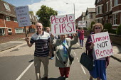 A march and rally in Urmston, Greater Manchester, to protest at the threatened cuts including closure of the Accident and Emergency department of Trafford General Hospital. The march marked the 64th b... - Paul Herrmann - 2010s,2012,Accident AND Emergency,activist,activists,against,age,ageing population,anti,Austerity Cuts,CAMPAIGN,campaigner,campaigners,CAMPAIGNING,CAMPAIGNS,CLOSED,closing,closure,closures,cuts,DEMONS