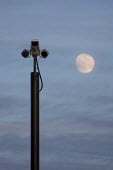 A closed-circuit security camera with infra-red lighting in front of the full moon - Paul Herrmann - 21-02-2002