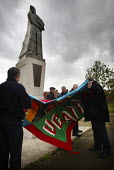 A UCATT banner is unfurled at the unveiling of a statue of a construction worker in Liverpool, in memory of people killed at work. Worker's Memorial Day 2002. - Paul Herrmann - 28-04-2002
