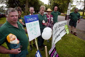 Unison park workers picketed the RHS Flower Show at Tatton Park, Cheshire on the day of strikes by local government workers. Placard reads Even gnomes say no to three percent - Paul Herrmann - 2000s,2002,authority,council,DEMONSTRATING,demonstration,DISPUTE,DISPUTES,EARNINGS,EQUALITY,gnome,government,Income,INCOMES,INDUSTRIAL DISPUTE,inequality,living wage,local,local authority,low,Low Pay,