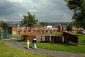 An asian mother and daughter walk through a play area in Rochdale, Lancashire, UK - Paul Herrmann - 06-10-2002