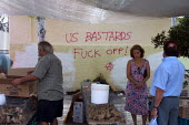 Anti American graffiti on a wall at a street market in Crete, Greece. The island has a large US military presence - Paul Herrmann - 21-09-2002
