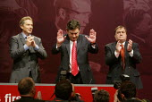 Chancellor of the Exchequer Gordon Brown acknowledges applause from the audience, with Prime Minister Tony Blair and John Prescott, after speaking at Labour Party Annual Conference 2002, Blackpool, UK - Paul Herrmann - 30-09-2002