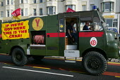 FBU protest, driving an old army Green Goddess fire engine past the conference venue in support of a pay claim. Banner reads If were not here this is the gear - support your firefighters, Labour Party... - Paul Herrmann - 2000s,2002,activist,activists,adult,adults,CAMPAIGN,campaigner,campaigners,CAMPAIGNING,CAMPAIGNS,conference,conferences,DEMONSTRATING,DEMONSTRATION,DEMONSTRATIONS,DRIVER,DRIVERS,driving,Emergency Serv