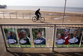 A cyclist rides past an anti nuclear, pro wind power display outside the Labour Party Annual Conference 2002, Blackpool, UK - Paul Herrmann - 2000s,2002,atomic,beach,BEACHES,bicycle,BICYCLES,BICYCLING,Bicyclist,Bicyclists,BIKE,BIKES,COAST,coastal,coasts,Conference,conferences,conservation,conservationist,cycle,cycles,CYCLING,Cyclist,Cyclist