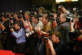 A crowd of hot sweaty photographers lines up to photograph prime minister Tony Blair at Labour Party Annual Conference 2002, Blackpool, UK - Paul Herrmann - 2000s,2002,camera,cameras,canon,celebrity,Conference,conferences,crush,EBF economy,flash,media,minister,nikon,Party,photograph,photographer,photographers,photography,press,scrum