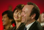 Cherie Blair gazes at actor Kevin Spacey, who is watching former US President Bill Clinton speak at Labour Party Annual Conference 2002, Blackpool, UK - Paul Herrmann - 2000s,2002,ACTING,actor,ACTORS,adoring,American,americans,Booth,booths,Conference,conferences,EMOTION,EMOTIONAL,EMOTIONS,FEMALE,funny,Humor,HUMOROUS,HUMOUR,joking,laugh,laughing,LAUGHTER,Party,people,