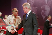 At the end of his speech, former US President Bill Clinton is accosted by a fan Sami Kiriakos, while Tony Blair looks on, at Labour Party Annual Conference 2002, Blackpool, UK - Paul Herrmann - 02-10-2002