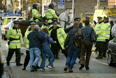 Anti Nazi League protestors are prevented by police from approaching a small National Front rally in Shaw, near Oldham UK. - Paul Herrmann - 26-10-2002