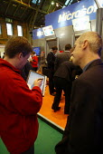 A Microsoft employee demostrates a new Tablet PC computer with handwriting recognition to a businessman at the CBI conference in Manchester. - Paul Herrmann - 25-11-2002