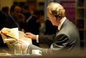 A businessman reads the Financial Times during a break at the CBI conference in Manchester. - Paul Herrmann - 25-11-2002