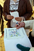 A demonstrator prepares a card for the family of murdered Asian taxi driver Israr Hussain, at a march orgainsed by the TUC and anti racist groups in Oldham, Lancashire after the murder of Asian taxi d... - Paul Herrmann - 04-01-2003