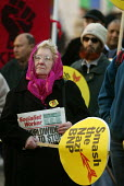 Elderly woman at a march organised by the TUC and anti-racist groups in Oldham, Lancashire after the murder of Asian taxi driver Israr Hussain. - Paul Herrmann - 04-01-2003