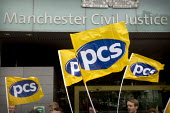 PCS flags blowing in wind at a picket and demonstration outside Manchester Civil Justice Centre, UK, part of one-day strike over civil service pay cap. - Paul Herrmann - 2010s,2014,campaign,CAMPAIGNING,CAMPAIGNS,court courts,dispute,DISPUTES,EARNINGS,EQUALITY,Fair,FLAG,flag flags,flags,Income,INCOMES,INDUSTRIAL DISPUTE,inequality,living wage,low pay,Low Income,low pai