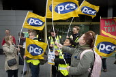 Strong wind blowing flags at PCS picket and demonstration outside Manchester Civil Justice Centre, UK, part of one-day strike over civil service pay cap. - Paul Herrmann - 15-10-2014