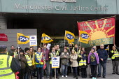 PCS picket and demonstration outside Manchester Civil Justice Centre, UK, part of one-day strike over civil service pay cap. - Paul Herrmann - 2010s,2014,banner banners,campaign,CAMPAIGNING,CAMPAIGNS,court courts,dispute,DISPUTES,EARNINGS,EQUALITY,Fair,FLAG,flag flags,flags,Income,INCOMES,INDUSTRIAL DISPUTE,inequality,living wage,low pay,Low