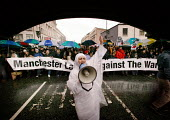Anti-war march in Manchester. Banner reads Manchester Labour Against the War. - Paul Herrmann - 2000s,2003,activist,activists,Against,anti war,Antiwar,arabic,arch,asian,BAME,BAMEs,black,BME,bmes,burka,burkas,burkha,burqa,burqas,CAMPAIGN,campaigner,campaigners,CAMPAIGNING,CAMPAIGNS,cultural,DEMON