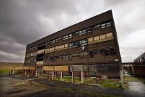 Derelict flats under a dark sky in Oldham, Lancashire, UK - Paul Herrmann - 12-03-2003