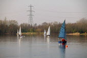 Small sailing boats under a pylon at an urban water park in Sale, Greater Manchester - Paul Herrmann - 18-03-2003