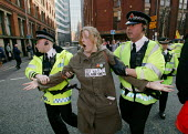 Police arrest a young anti-war protestor in Manchester. Slogan reads No War Blair Out. - Paul Herrmann - 2000s,2003,activist,activists,adult,adults,Anti War,Antiwar,arrest,arrested,arresting,arrests,CAMPAIGN,campaigner,campaigners,CAMPAIGNING,CAMPAIGNS,CLJ Crime law,DEMONSTRATING,demonstration,DEMONSTRAT