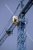 A plane flies over a tower crane on a building site - Paul Herrmann - 2000s,2003,aeroplane,AEROPLANES,air transport,aircraft,airplane,AIRPLANES,aviation,blue,building,BUILDINGS,Construction Industry,crane,CRANES,EBF,Economic,economy,employee,employees,Employment,height,