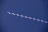 Vapour trail behind a high-flying plane - Paul Herrmann - 2000s,2003,aeroplane,AEROPLANES,air pollution,air transport,aircraft,aircraft exhaust,airplane,AIRPLANES,airspace,aviation,Blue Sky,climate change,condensation trail,condensed,condensing,contrail,cont