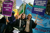 Two women at the Unite against Racism march organised by TUC and Unison in Manchester. Banners read Stand up for your rights againt racism and Refugees are welcome here - Paul Herrmann - 2000s,2003,activist,activists,against,anti racist,asian,Asylum Seekers,Asylum Seekers,BAME,BAMEs,BANNER,Banners,bigotry,black,BME,bmes,CAMPAIGN,campaigner,campaigners,CAMPAIGNING,CAMPAIGNS,DEMONSTRATI