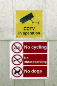 Signs prohibiting cycling, skateboarding and dogs, and warning of CCTV - Paul Herrmann - 2000s,2004,anti social behavior,anti social behaviour,anti socialanti social behavior,antisocial,antisocial behaviour,behavior,behaviour,bicycle,bicycles,BICYCLING,Bicyclist,Bicyclists,BIKE,BIKES,bye-