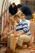 Students at Mancat college, Manchester, learn building and bricklaying skills - Paul Herrmann - 2000s,2004,adolescence,adolescent,adolescents,apprentice,Apprentices,apprenticeship,BRICK,bricklayer,bricklayers,bricklaying,bricks,builder,builders,by hand,college,COLLEGES,Construction Industry,EDU