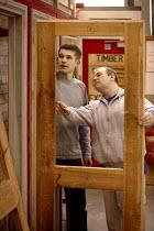 Student at Mancat college, Manchester, learns building and joinery skills - Paul Herrmann - 2000s,2004,adolescence,adolescent,adolescents,apprentice,Apprentices,apprenticeship,builder,builders,by hand,carpenter,carpenters,carpentry,college,COLLEGES,Construction Industry,door,doors,EDU educat