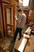Student at Mancat college, Manchester, learns building and joinery skills - Paul Herrmann - 2000s,2004,adolescence,adolescent,adolescents,apprentice,Apprentices,apprenticeship,builder,builders,building,BUILDINGS,by hand,carpenter,carpenters,carpentry,college,COLLEGES,Construction Industry,do