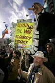 Anti-war protestors march through Manchester during the visit of Tony Blair and the Labour Party Spring Conference, with a giant effigy of Blair and a placard reading Blood Lies Oil War US Globocop Hy... - Paul Herrmann - 13-03-2004