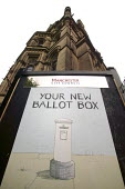 A advertisement for postal voting outside Manchester Town Hall. Sign reads Your new ballot box and shows a letter box. - Paul Herrmann - 2000s,2004,advertisement,ballot,BALLOTING,ballots,box,boxes,campaign,campaigning,CAMPAIGNS,communicating,communication,council,Council Services,Council Services,democracy,election,elections,government