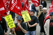 Amicus members march in Manchester in campaign to revive manufacturing jobs in the UK. Banners read Invest in UK not USA, BAe stop exporting British jobs. - Paul Herrmann - 05-06-2004