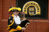 A piper plays a lament outside the Boddingtons Brewery in Manchester on its last day, 25 Feb 2005 - Paul Herrmann - 25-02-2005