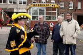A piper plays a lament for workers leaving the Boddingtons Brewery in Manchester on its last day, 25 Feb 2005 - Paul Herrmann - 25-02-2005