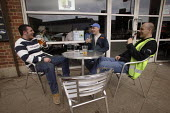 Workers enjoying a drink after a shift in Leeds, Yorkshire - Paul Herrmann - 12-04-2005