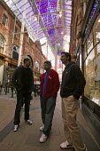 Three young Asian men in Victoria shopping quarter, Leeds, Yorkshire - Paul Herrmann - 12-04-2005