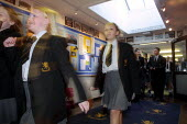 Pupils rushing to lessons down a corridor at Crompton House school, Shaw, near Oldham, UK - Paul Herrmann - ,2000s,2001,adolescence,adolescent,adolescents,blur,child,CHILDHOOD,children,Comprehensive School,corridor,EDU education,education,EMOTION,EMOTIONAL,EMOTIONS,enthusiasm,enthusiastic,female,females,gir