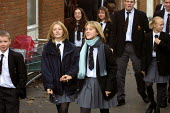 Pupils on their way to lessons at Crompton House school, Shaw, near Oldham, UK - Paul Herrmann - 2000s,2001,adolescence,adolescent,adolescents,beacon,BEACONS,child,CHILDHOOD,children,companion,Comprehensive School,EDU education,education,EMOTION,EMOTIONAL,EMOTIONS,female,females,friend,friendly,f