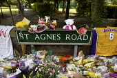 Racist murder of Anthony Walker in Liverpool during which his head was split open with an axe: floral tributes left at St Agnes Road at the entrance to McGoldrick Park where Anthony was killed. - Paul Herrmann - 02-08-2005