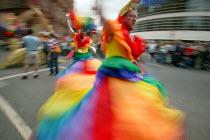 Gay men in rainbow dresses dance on the Manchester Pride Parade 2005 - Paul Herrmann - 27-08-2005