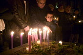 Candlelit vigil in Manchester, UK, to commemorate asylum seekers who have been detained, deported or died. 6-year-old Navid Rahimi from Iran, who has already spent a month in Yarls Wood detention cent... - Paul Herrmann - 28-01-2006