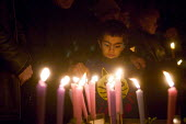 Candlelit vigil in Manchester, UK, to commemorate asylum seekers who have been detained, deported or died. Pic shows 6-year-old Navid Rahimi from Iran, who has already spent a month in Yarls Wood dete... - Paul Herrmann - 28-01-2006
