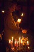Candlelit vigil in Manchester to commemorate asylum seekers who have been detained, deported or died. Pic shows 6-year-old Navid Rahimi from Iran, who has already spent a month in Yarls Wood detention... - Paul Herrmann - 2000s,2006,activist,activists,against,asylum,Asylum Seeker,Asylum Seeker,at,BME Black minority ethnic,CAMPAIGN,campaigner,campaigners,CAMPAIGNING,CAMPAIGNS,candle,candles,center,centre,centres,child,C