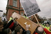 Thousands of protestors greeted Condoleezza Rice in Liverpool on her tour of NW England with Jack Straw. Here, police try to move a coffin representing war dead. Banner reads: The Wall Must Fall. - Paul Herrmann - 2000s,2006,activist,activists,adult,adults,anti war,anti-american,anti-US,Antiwar,anti-war,CAMPAIGN,campaigner,campaigners,CAMPAIGNING,CAMPAIGNS,casket,CLJ,coffin,DEMONSTRATING,demonstration,DEMONSTRA